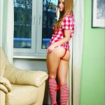 Ankara escort girl named Veronica is standing at the window, she is wearing thin lacy red panties and her shapely legs and firm buttocks are fully exposed, she looks straight into the camera
