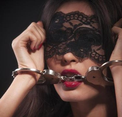 Escort service Ankara girl in a seductive mask and handcuffs is waiting for her man ready for experiments