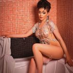 Escort Whatsapp Yana is sitting in a bath covered with foam totally naked, only the broad necklace covers some part of her skin