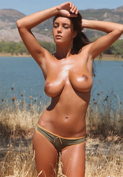 Girl Ankara Kiriusha is standing half-naked (without her bra) revealing her breasts of the third size to all beholders