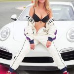 Bayan eskortlar Caroline shows her boobs in black bra sitting in a sports car in a white suit
