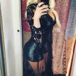 Blonde escorts uk girl Lianna is in the evening dress with sparkling pieces all over its surface