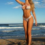 Blonde escorts uk chick Lianna is on the beach showing her slimness and long legs