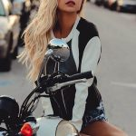 Outcall escort service girl Svyatoslava takes off the bike giving a sexy and arousing look