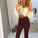 Ankara escort bayan wears stylish differently-colored top and bottom and gives us a kiss