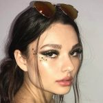 Bayan eskortlar girl has a tired face with little bit closed eyes and she has funny stars in makeup