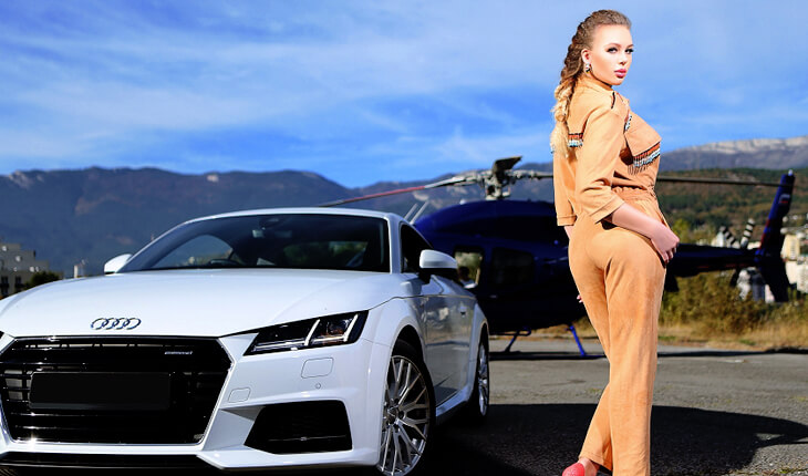 Ankara Rus eskortlar Ulyana is in the background of a fancy sports car and black helicopter